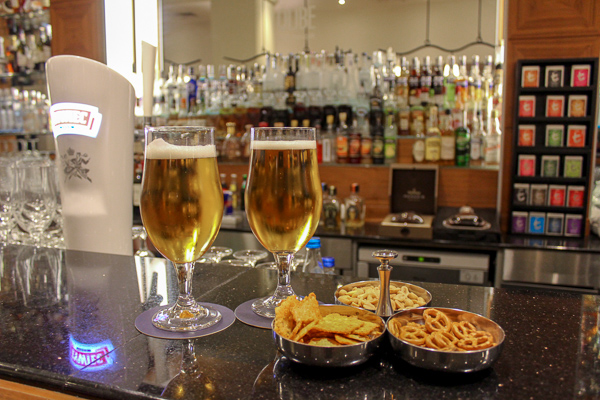 Beers and pretzel snacks at the hotel bar. In the background you can see an array of drinks available