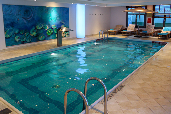 The gorgeous pool available with seating area. One reason this is a great place to stay in Krakow