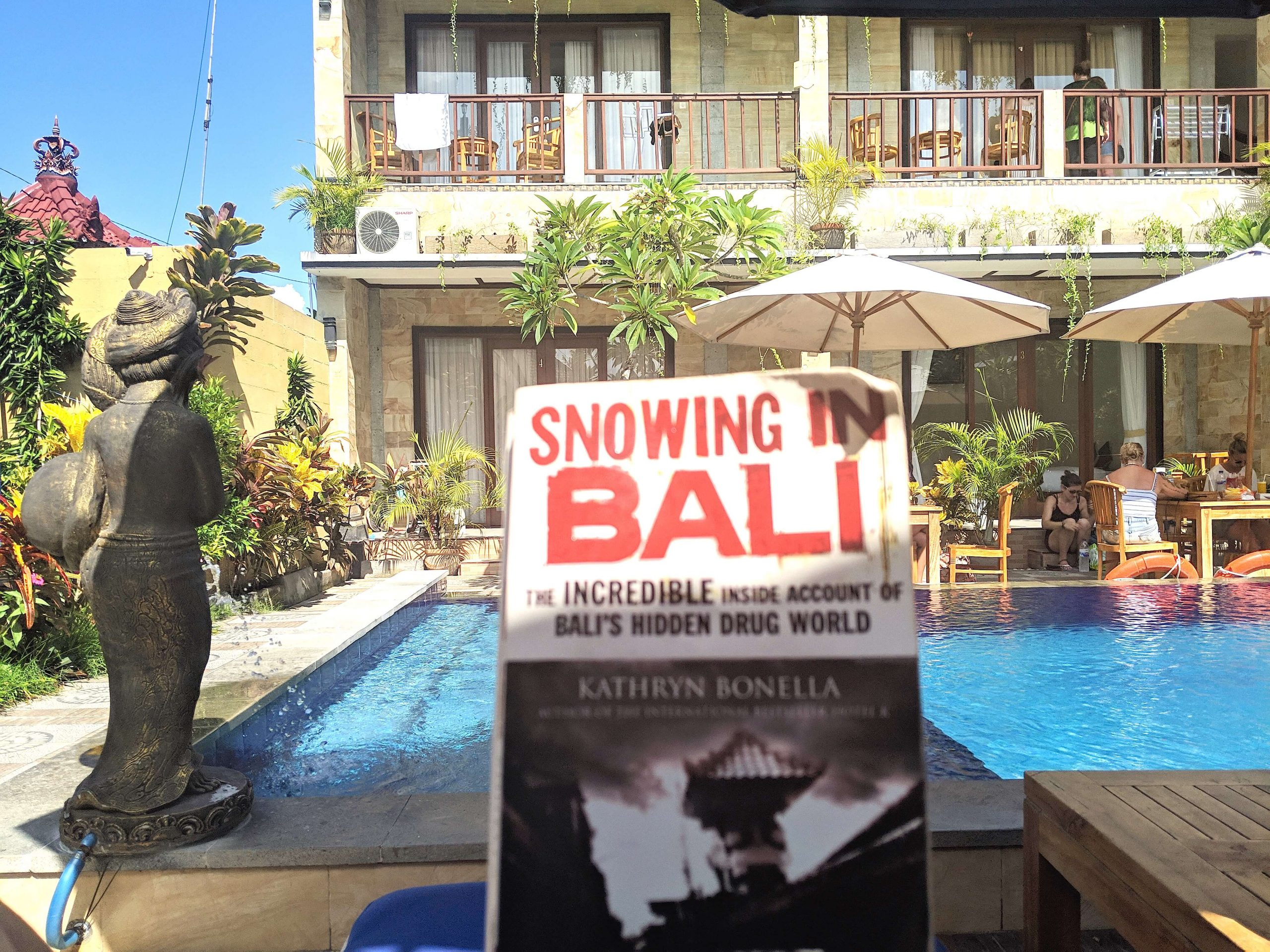 Sat reading Snowing in Bali by the pool - just 1 of the awesome books I read in 2019