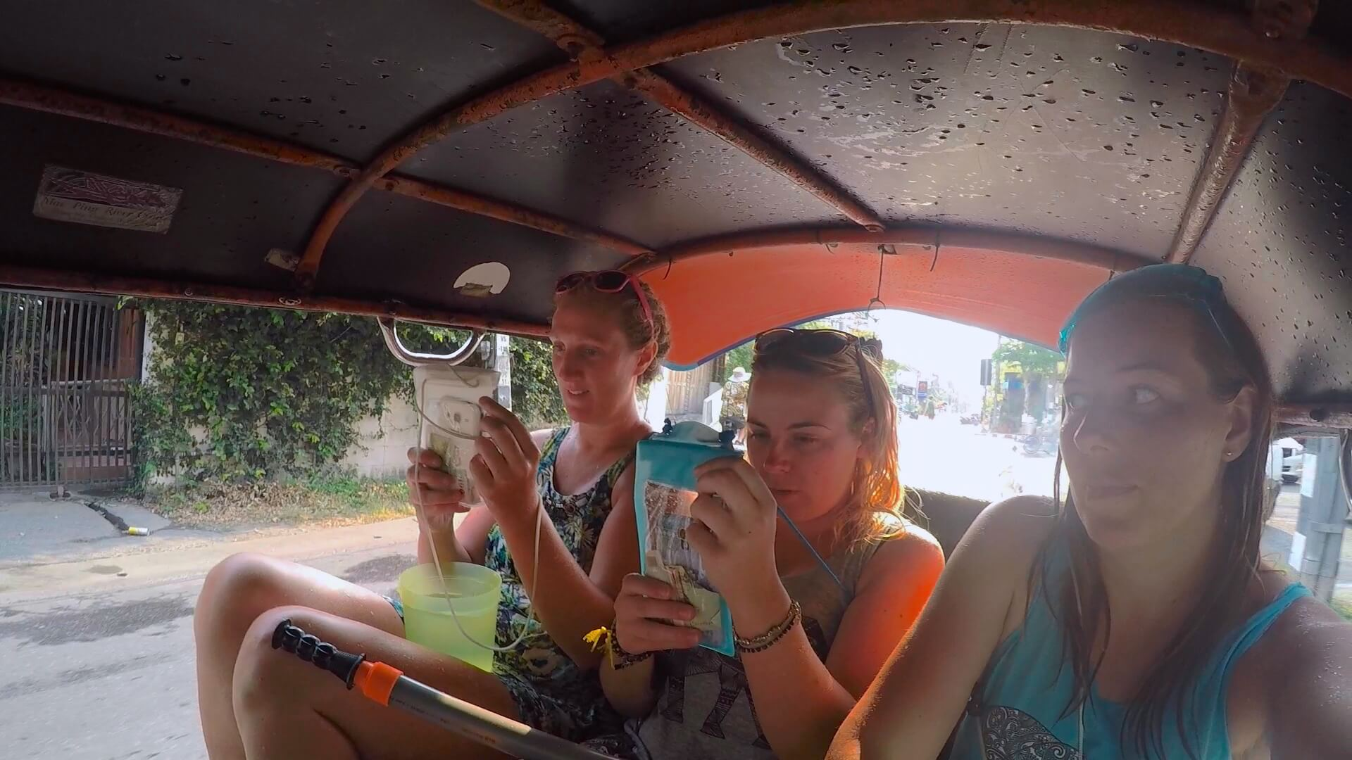 Enjoying riding around in a tuk tuk during Songkran Festival in Chiang Mai