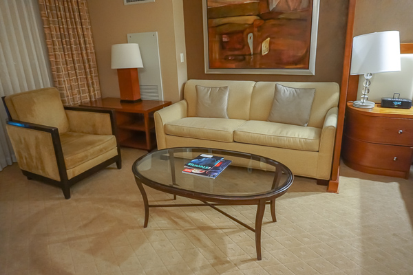 Spacious seating area with comfy seats in the suites at The Signature Hotel in Las Vegas