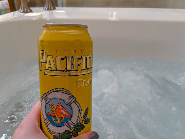 Enjoying a beer while relaxing in the whirlpool spa tub