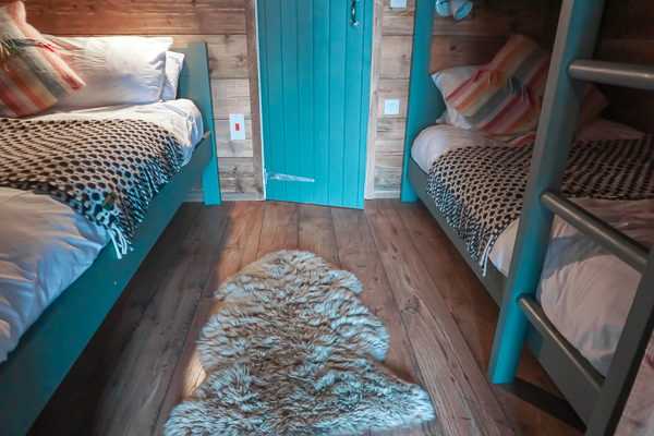Comfortable kingsize bed and bunk bed is why The Slate Caverns is Luxuery glamping in Snowdonia, North Wales