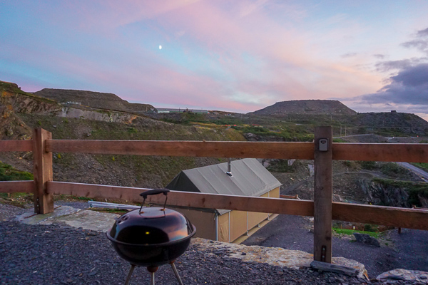 Slate Cavern Glamping comes with a BBQ so you can watch the sunset while cooking dinner in your luxury safari lodge