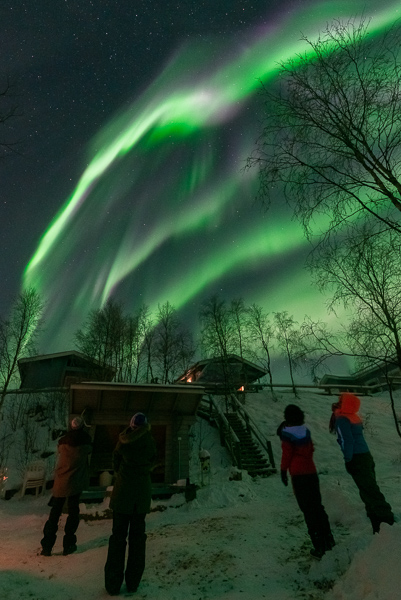 The beautiful green and purple light show of the northern lights in the sky of Utsjoki