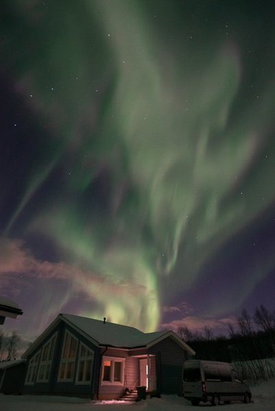 One of the most beautiful displays of the northern lights - with strong greens and purples - flickering above the restaurant