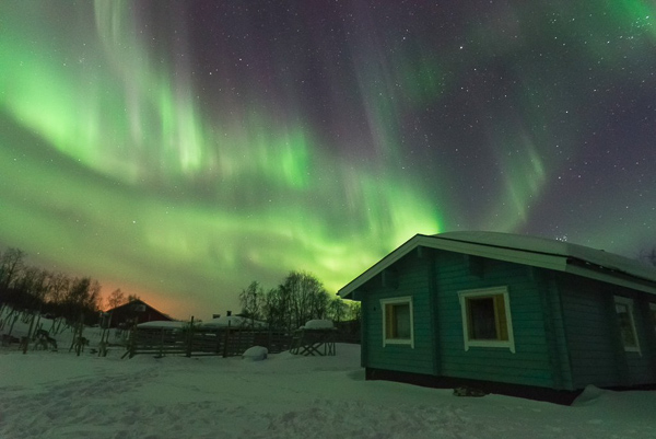 One of the most beautiful displays of the northern lights - with strong greens and purples - flickering above the cottages