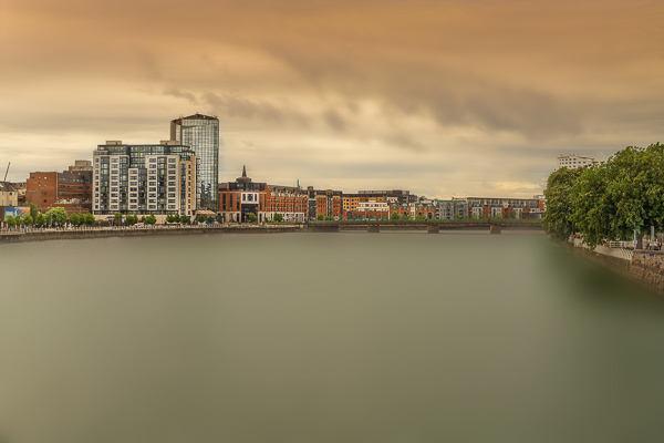 The moody shot of the River Shannon with the Clayton Hotel Limerick in the background