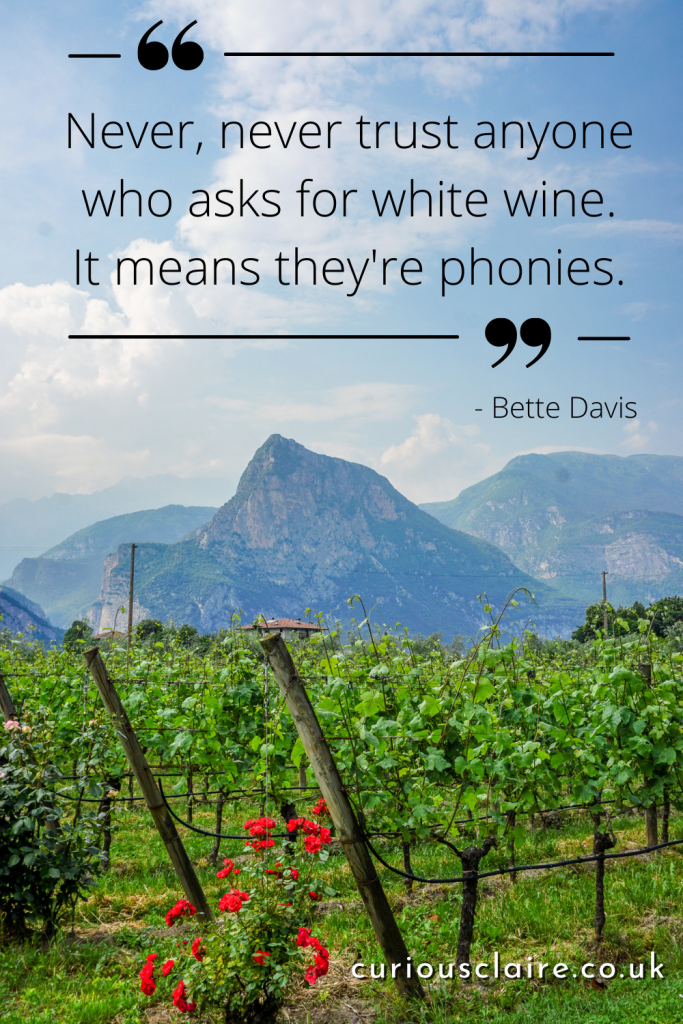"""""""Never, never trust anyone who asks for white wine. It means they're phonies."""" - Bette Davis - A funny wine quote from a famous figure"""
